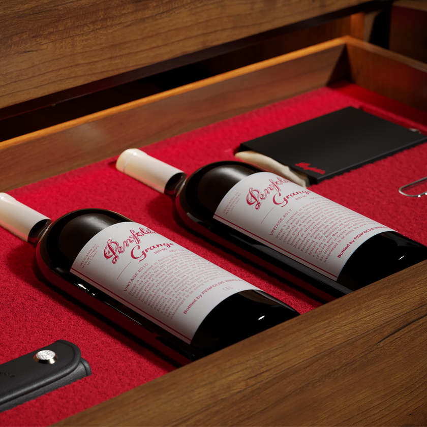 Open drawer reveals two Grange magnums with white capsules