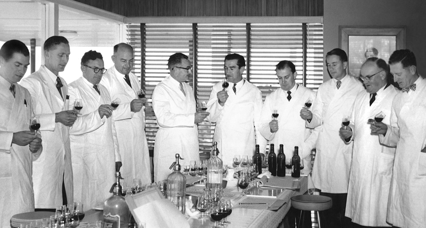 The Penfolds winemaking team during a tasting in the late 1950s