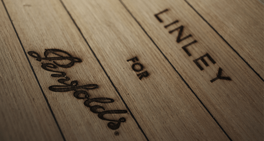 Linley for Penfolds debossed on wood panel
