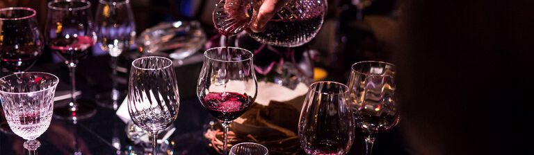 Shiraz being poured from a crystal decanter at a formal gala dinner table