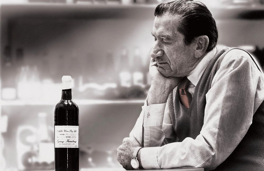 An older Max Schubert looks at an early release Grange bottle