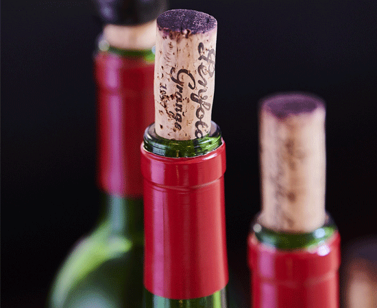 Penfolds Grange bottles with cork partially removed