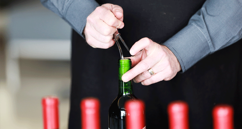 Cork being removed from a Penfolds bottle