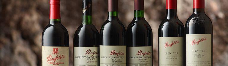 Line up of 7 Bin 707 Cabernet bottles of varying ages