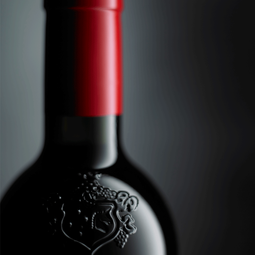 Close up Penfolds bottle. Embossed crest in glass with red cork capsule