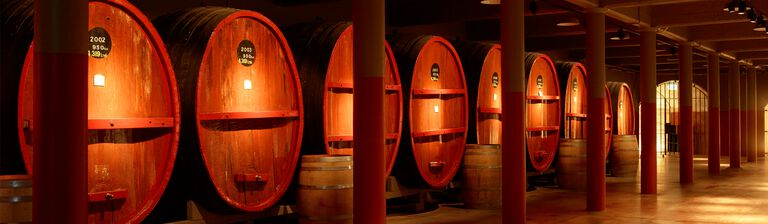 Large, aged St Henri barrels in the historic tunnels of Penfolds Magill Estate