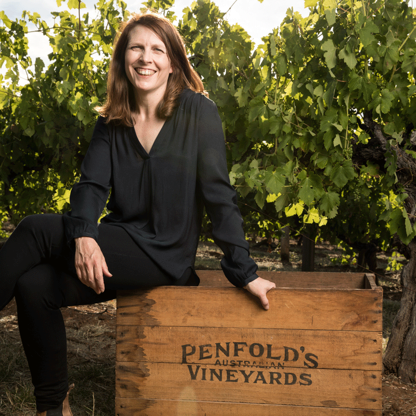 Shavaughn Wells, Penfolds Winemaker, sits on a wooden wine crate in the vineyards