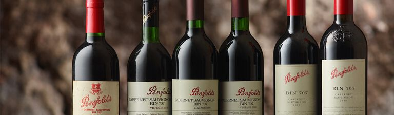Line up of 7 Bin 707 Cabernet bottles of varying ages