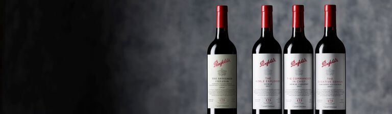 Four Penfolds Tribute range bottles against a grey background