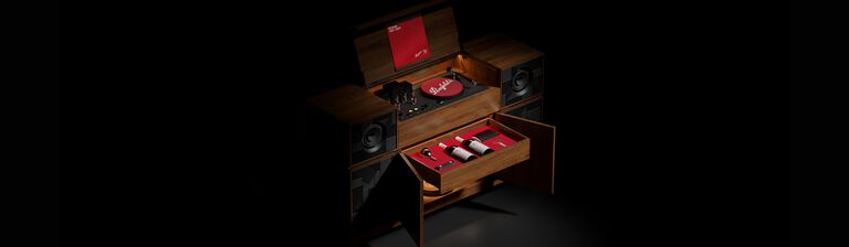 Grange record player console against black background.  A red record sits on top, two drawers are open to reveal two Grange magnums