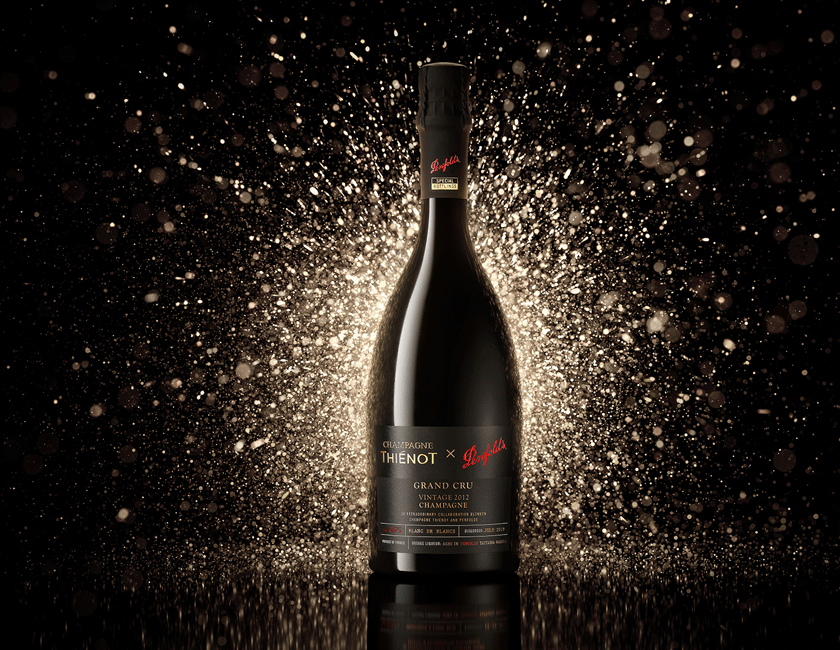 Penfolds x Thienot Champagne with gold sparkle background