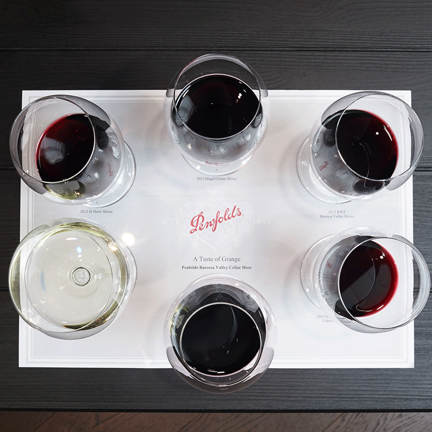 Overhead photo of a tasting mat with 6 filled with glasses