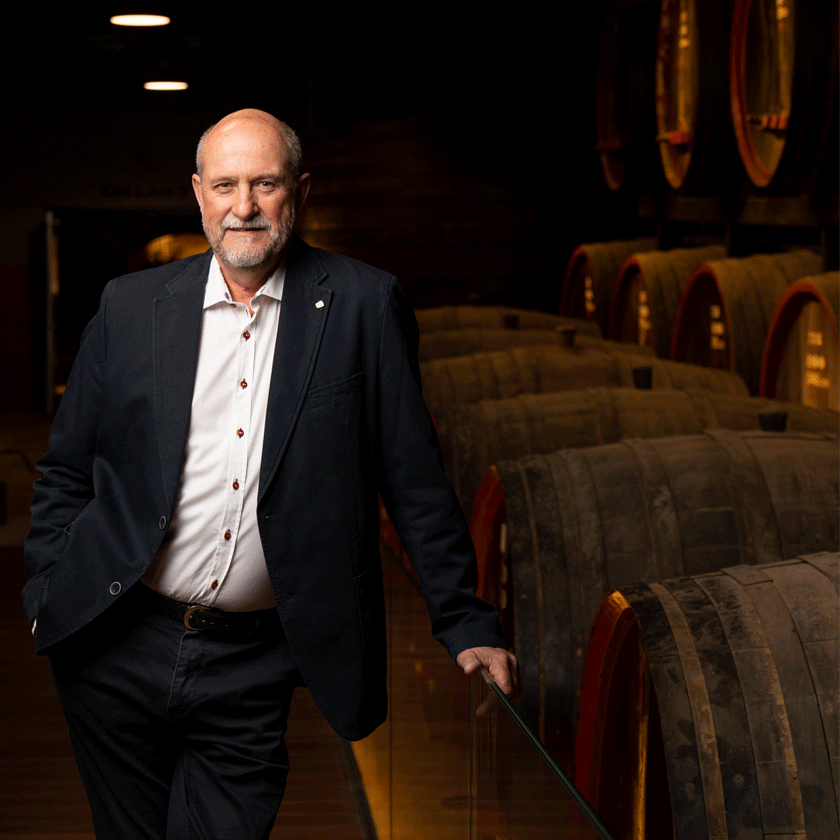 James Godfrey, Penfolds Fortified Winemaker, stands in the warmly lit tunnels of the winery