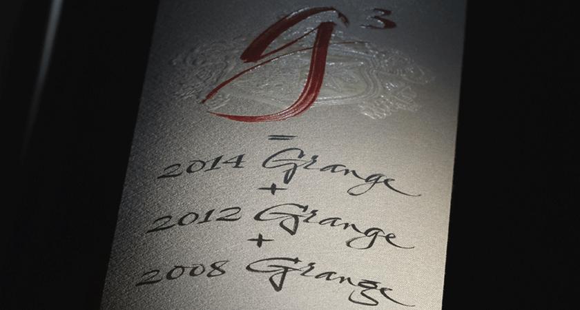 Close up of Penfolds g3 back label.  Calligraphy script shows g^3, 2014 Grange, 2012 Grange and 2008 Grange