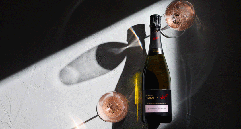 Champagne rose bottle with two filled glasses. Shot from overhead with the glasses casting shadows