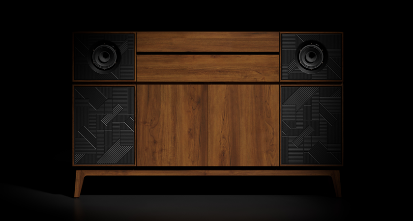 Closed record console against black background.  Wood paneling and black speakers are visible.