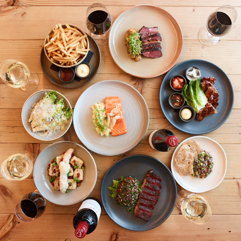 Overhead shot of Kitchen lunch dishes with wine glasses
