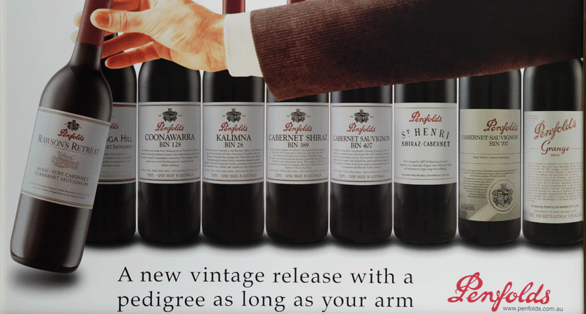 'A new vintage release with pedigree as long as your arm'. 1950s advertising for Bin 28 Shiraz. Hand reaches for bottle