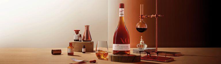 Penfolds brandy bottle amongst beakers and a bunse burner
