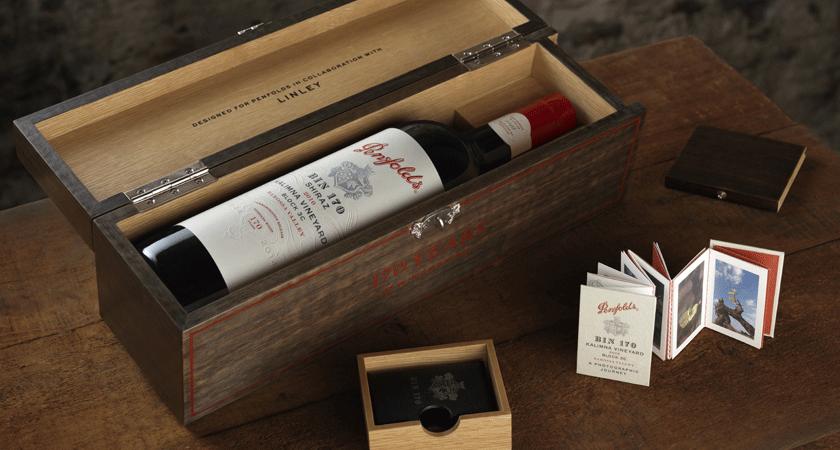 Overhead shot of Bin 170 Shiraz bottle in wooden Linley collaboration gift box